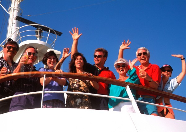 Couples waving as cruise ship leaves dock