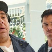 Dean Cain and Joey Diaz in The Dog Who Saved Christmas