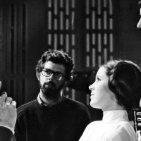 Peter Cushing, David Prowse and Carrie Fisher with George Lucas on the set of Star Wars: Episode IV - A New Hope